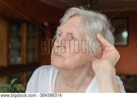 Portrait Of Grandmother Trying To Hear Something. Old Lady Is Having Difficulty With Auditory Percep