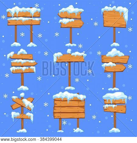 Snowed Sign Boards. Blank Brown Wooden Signpost, Direction Street Arrows With Icicles In Snowdrift,