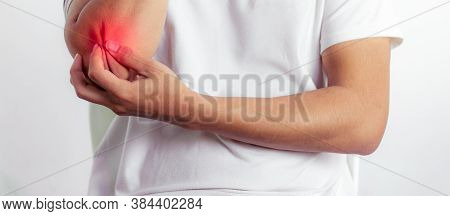 Closeup On Man With Elbow Pain.with Copy Space For Text Or Design