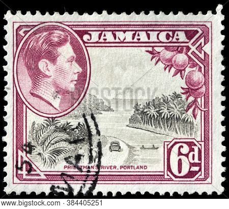 Luga, Russia - April 10, 2020: A Stamp Printed By Jamaica Shows Image Portrait Of King George Vi Aga