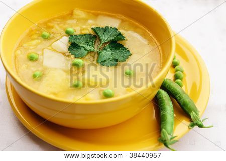Meatless Soup In Round Yellow Cup.
