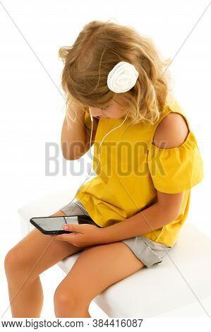 Cute Little Kid Girl Wearing Headphones Listening To Music. Kid Listening To Music. Music Recommende