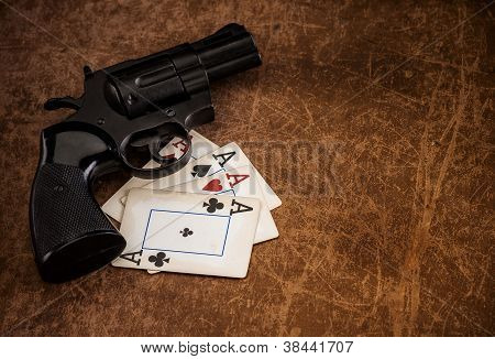 Black Revolver And Old Playing Cards