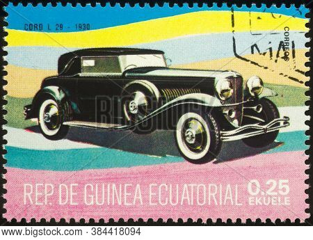 Moscow, Russia - September 07, 2020: Stamp Printed In Equatorial Guinea Shows American Retro Car Cor