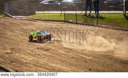 Rc Shortcourse Going Down The Main Straight And Leaving Dust Trail Behind