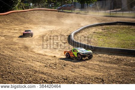 Two Offroad Rc Cars Racing On A Track