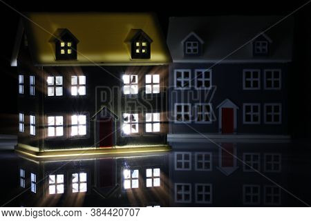 Toy House At Night With The Lights On Indoors