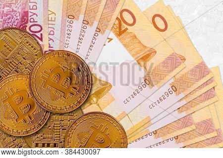 20 Belorussian Rubles Bills And Golden Bitcoins. Cryptocurrency Investment Concept. Crypto Mining Or