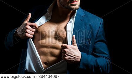 Fashionable Young Man Wearing Suit Posing Over Black Background. Handsome Man Posing In White Shirt