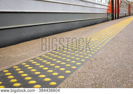Direction Signs For The Visually Impaired On The Train Platform, Accessible Environment For The Blin