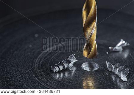 Metal Drill Bit Make Holes In Steel Billet On Industrial Drilling Machine. Metal Work Industry. Mult