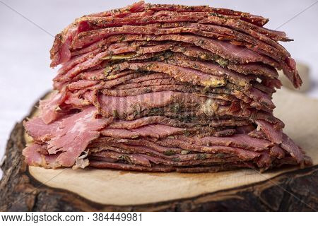 Closeup Of A Stack Of Sliced Pastrami Meat