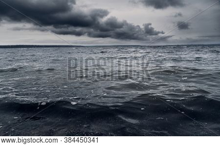 dark stormy sea and dramatic clouds, gloomy nature