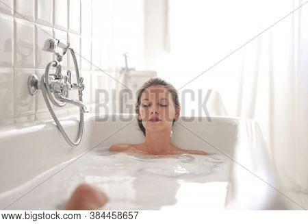 portrait of beautiful woman in bathtub