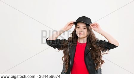Hipster Style. Modern Fashion Style. Happy Kid In Stylish Leather Jacket. Small Girl Wear Cap. Kid F