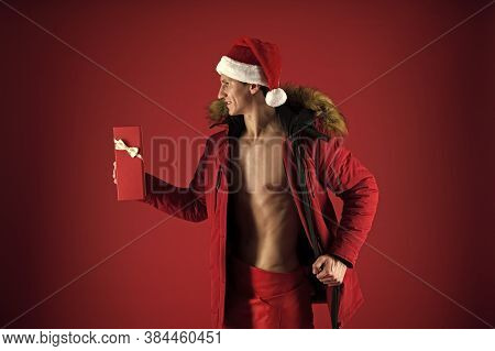 Santa Courier. Athletic Macho Muscular Chest Santa Claus Hat And Jacket. Sexy Surprise. Gift Deliver