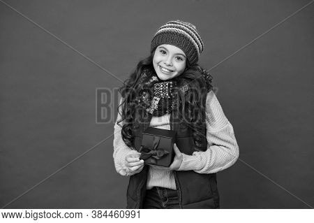 Winter Holidays. Happy Kid In Winter Outfit Red Background. Pick Some Winter Gifts For Yourself. Wis