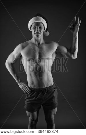 Excellent Shape. Santa Claus Diet. Athlete Man Wear Santa Hat. Sexy Athletic Macho In Santa Claus Ha