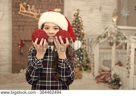 Cheerful Kid. Kid Santa Hat Decorating Christmas Tree. Decorating Her Favorite Activity. Decor Shop.