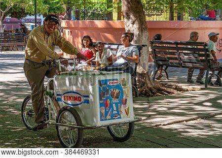 Leon, Nicaragua - November 27, 2008: Ice Cream Vendor On Tricycle Selling Eskimo Brand, While 3 Ladi