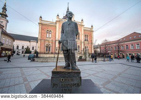 Novi Sad, Serbia - December 4, 2016: Serbian Poet Jovan Jovanovic Zmaj Statue In Front Of Vladicin D