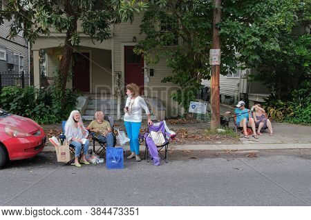 New Orleans, Louisiana/usa - 8/15/2020: Neighborhood Spectators Enjoying Front Porch Concert In Upto