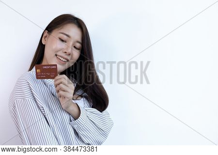 Young Asian Business Woman Holding A Credit Card And Smiling Happily, Credit Card Purchases, Technol