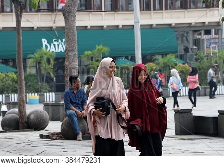 Jakarta, Indonesia May 6, 2019: Two Muslim Women Indonesian Walking In The Fatahillah Square At Old