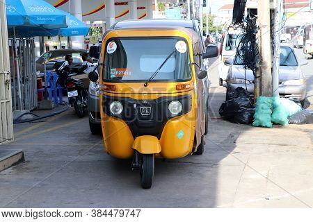 Phnom Penh, Cambodia, August 17, 2019 : Tuk Tuk Or Taxi Tricycle In Yellow Color On The Road, Lifest