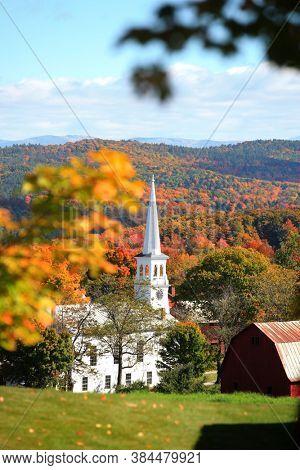 Historic church in Peachem village in Vermont during autumn time