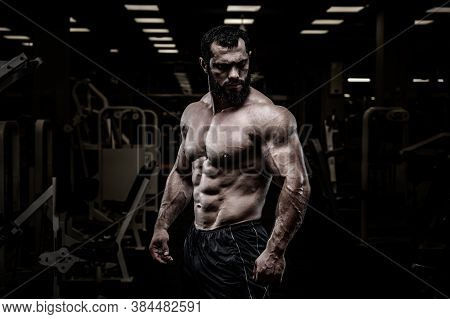 Handsome Healthy Young Strong Bearded Caucasian Man With Perfect Sport Physique Body In Dark Athlete