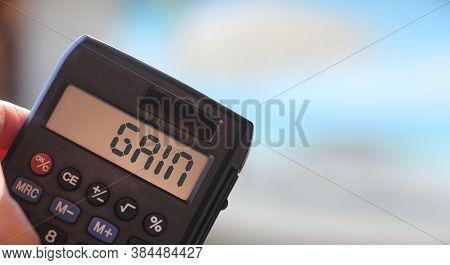 Gain Text On Calculator Display, Defocused Sea Beach. Profitable Business Concept