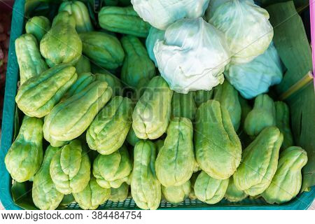 Fresh Chayotes (sechium Edule) Piled On Table In Stall Market. Pile Of Chayote Fruits. Fresh Vegetab