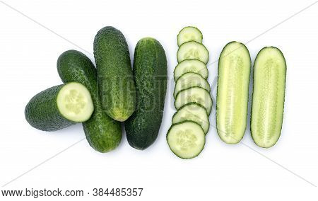 Group Of Fresh Little Cucumber. Mix Of Whole, Chopped And Sliced Cucumbers Isolated On Wite Backgrou