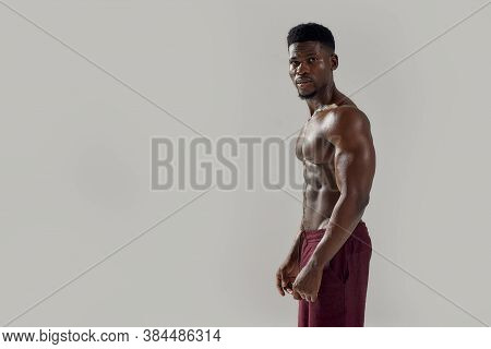 Feel Fit. Young Muscular African American Man With Naked Torso Looking At Camera While Posing Shirtl