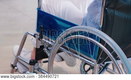 Disabled Old Woman Holding Hands On Chair Wheell In Hospital Hallway. Disabled Disability Handicappe