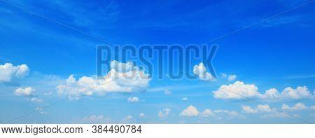 Beautiful white clouds on blue sky. Panorama