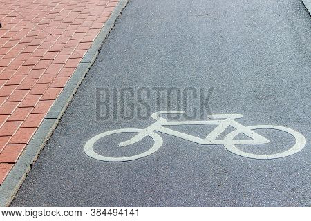 City Bike Path . Paved Roads For Bicyclists In The City. Bike Lane Sign. The Article Is About Cyclis