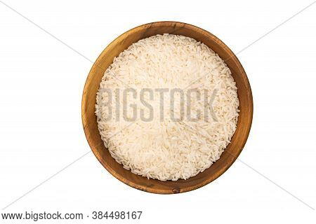 Top View Of Jasmine Rice In A Wooden Bowl On White Background With Clipping Path.