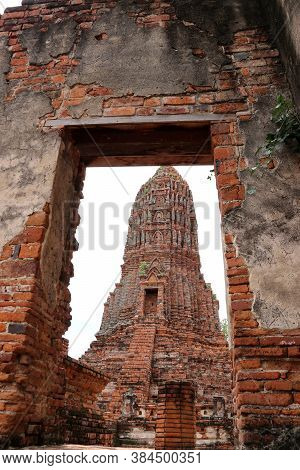The Main Phra Prang Or Pagoda, The View Through The Door Of Church In The Ruins Of Ancient Remains A