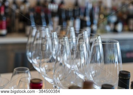 Empty Glasses For Wine Near A Bar Rack, Close Up