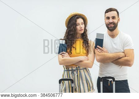 Image Of Ecstatic Couple While Holding Passport With Travel Tickets Isolated Over White Background.