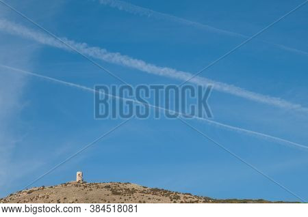 Observation Tower And Contrails Of Airplanes In The Sky.