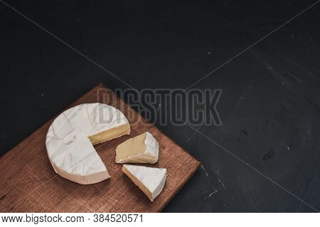 Cheese Camembert With Mold On Cutting Board