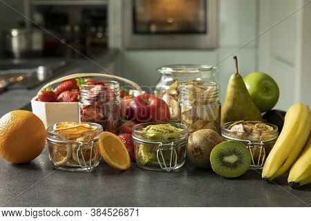 Dried Fruits And Fruit Chips Along With The Fresh Fruit Of Which They Are Made. Dietary Nutrition. N