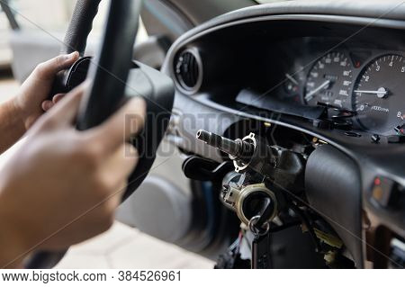 Close Up Car Steering Wheel Repair After The Accident. Disconnecting Of Driver's Airbag. With Soft-f