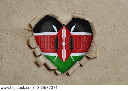 3d Illustration. Heart Shaped Hole Torn Through Paper, Showing Kenya Flag