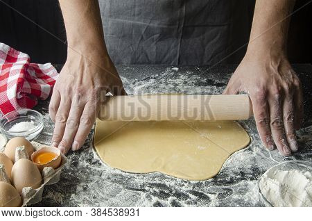The Mans Hands Prepare The Dough For The Preparation Of Pizza And Home Baking