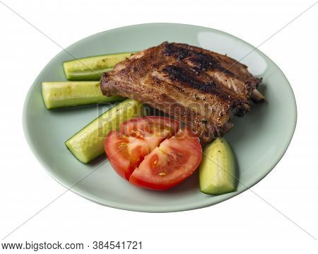 Grilled Pork Ribs With Sliced Cucumbers And Tomatoes On Light Green Plate. Pork Ribs Isolated On Whi