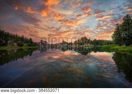 Stunning Multicolored Sunrise Reflecting On Sylvan Lake In Custer State Park, Sd